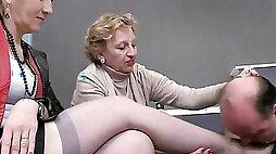 Kinky man is worshipping feet of those naughty mature ladies