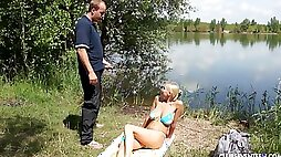 Nude passion by the lake with a busty teen keen to suck dick