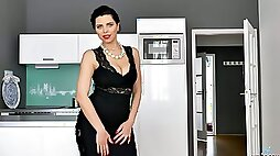 Wank while watching lovely busty MILF Kira Queen stripteasing