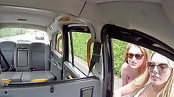 Stacy Seran and Princess Paris take turns on a cab driver