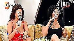 Upskirt and Downblouse of Turkish Singer Tuba Ekinci