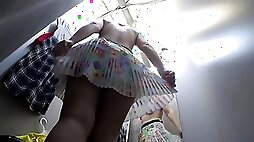Hidden camera in a public fitting room records a girl with long legs and a big ass in nylon pantyhose. Fetish.