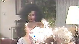 Retro black shemale fucks with a sexy maid in bed