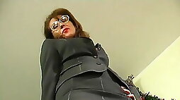 Mature boss in stocking seduces guy in office