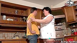 German fat chubby housewife with big natural boobs in kitchen
