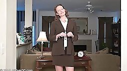 Naughty MILF with curly hair fondling her juicy honeypot