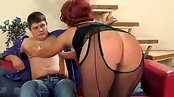 Sexy russian mature in black stockings punishes boy