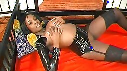 Ebony poses in her sweet sexy leather skirt