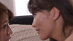 Japanese MILF has fun with her little girlfriend on the couch