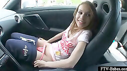 Blonde appealing teen masturbating cunt in a car
