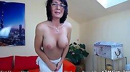 Wet mature woman masturbating