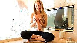 A fuckin blonde sticks a huge cock-shaped dildo in her gash