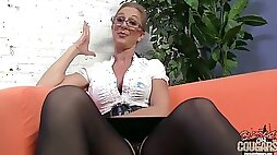 Mature woman in glasses shows her big boobs in a backstage